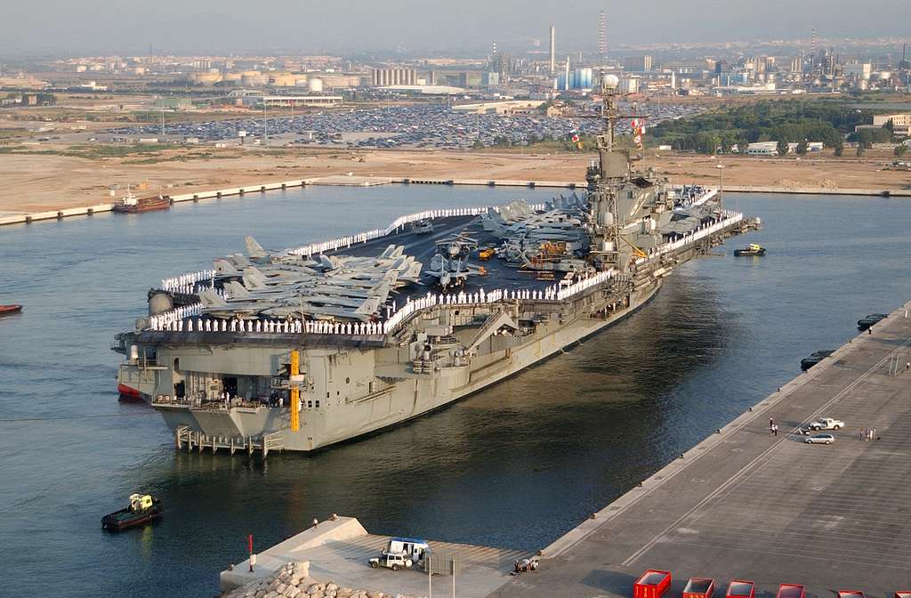 USS Kennedy (CV 67) pulls into Spain for a port visit.