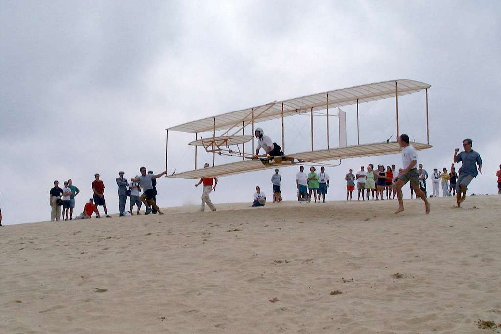 Lt. Cmdr. Klas Ohman, from aboard USS Kitty Hawk (CV 63), completes a flight in a replica of the 1902 Wright brothers' glider