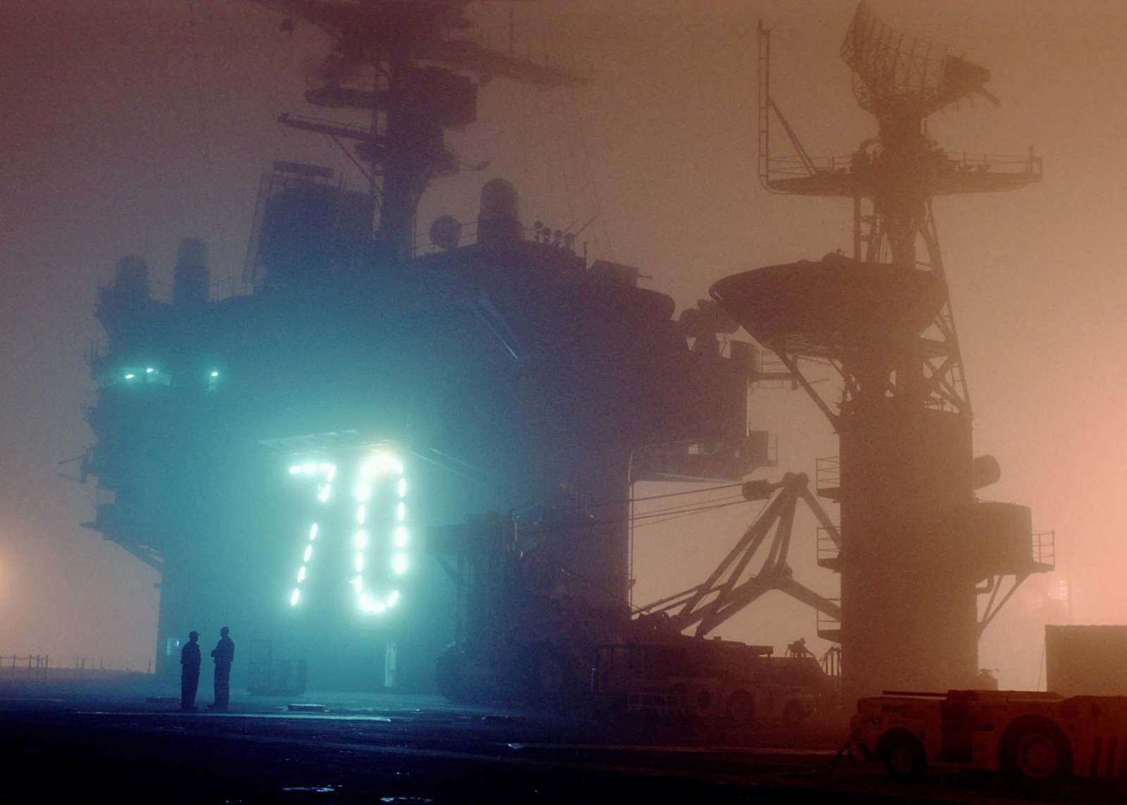 Early morning fog sets across the flight deck of the aircraft carrier USS Carl Vinson