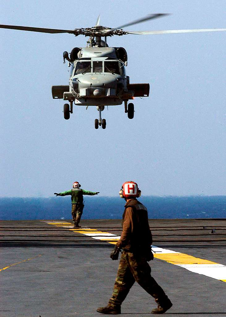 AN SH-60B Seahawk helicopter, assigned to the Saberhawks of Helicopter Anti-Submarine Light Squadron Four Seven (HSL-47), prepares to land on the flight deck aboard USS Abraham Lincoln (CVN 72).