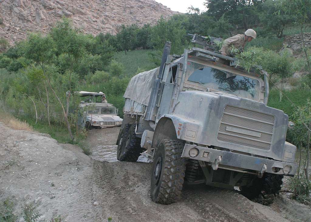 A convoy assigned to the Battalion Landing Team ground combat element of the 22nd Marine Expeditionary Unit (MEU) (special operations capable), makes its way through treacherous terrain .