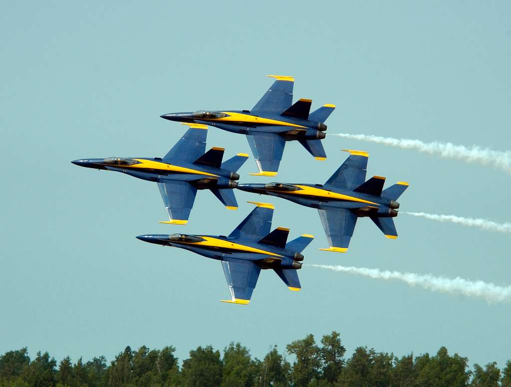 The U.S. Navy flight demonstration team, the Blue Angels, Diamond Formation completes a 360 degree turn.