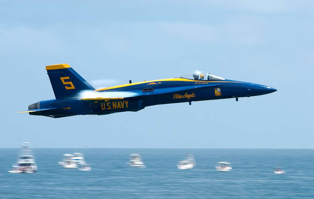 The Lead solo pilot, assigned to the U.S. Navy flight demonstration team, the Blue Angels, performs the Sneak Pass