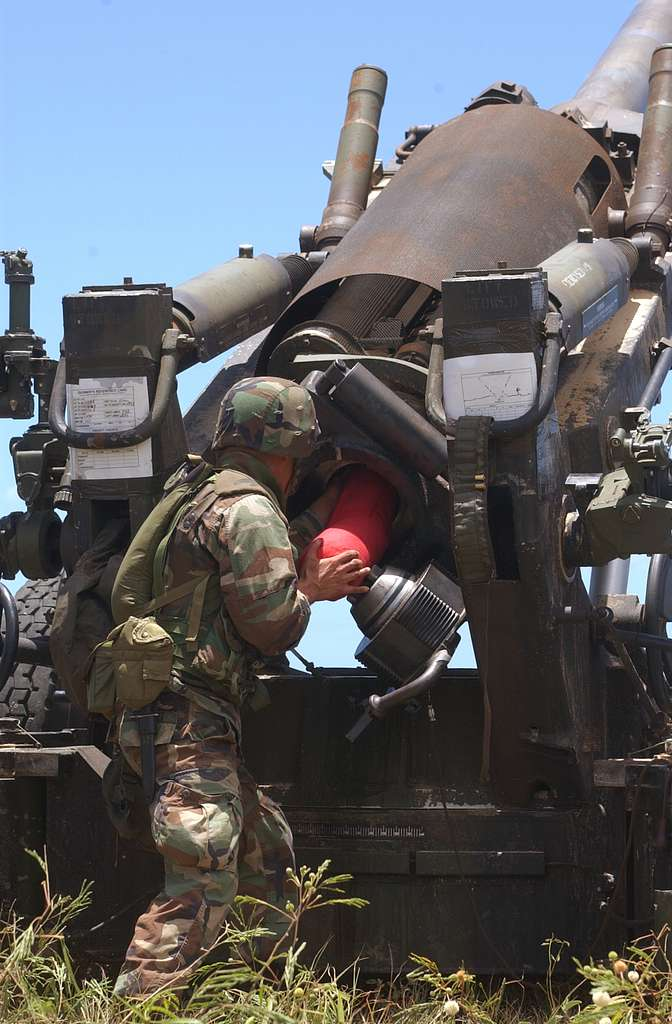 Lance Cpl. Ramon Gallego, assigned to First Battalion, Twelfth Marine Regiment, loads a charge round.
