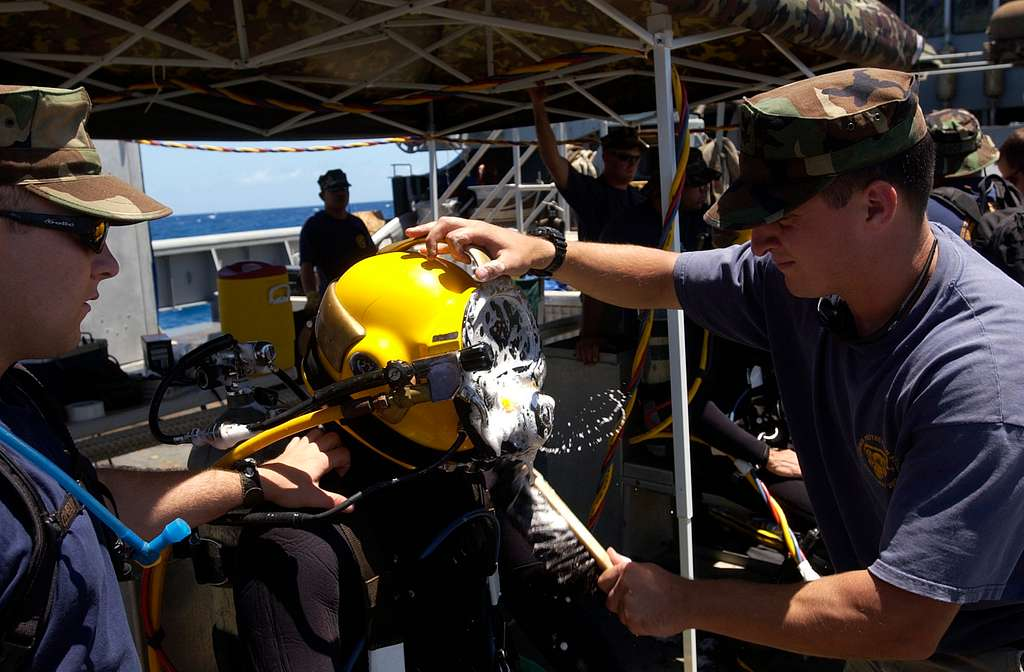 Boatswain's Mate 2nd Class Jack McPherson performs a leak check on the MK-21 Underwater Breathing Apparatus worn by Hull Maintenance Technician 2nd Class Jody Kappen aboard USNS Sioux (T-ATF 171).