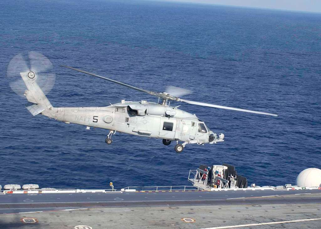An SH-60F assigned to the Light Helicopter Anti-Submarine Four Seven (HSL-47), takes off from the aircraft carrier USS Abraham Lincoln (CVN 72).