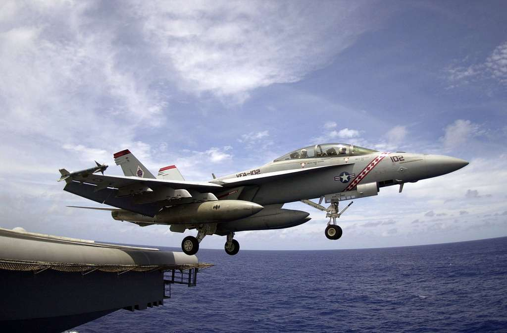 An F/A-18F Super Hornet, assigned to the Diamondbacks of Strike Fighter Squadron One Zero Two (VFA-102), launches.