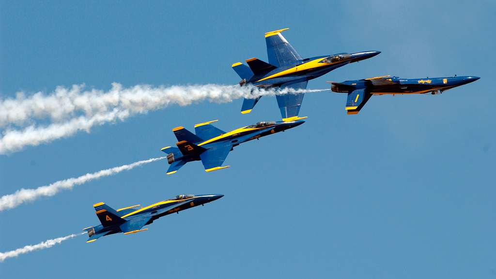 The U.S. Navy flight demonstration team, the Blue Angels, left echelon formation rolls 270 degrees in ripple fashion performing the Tuck Under Break.