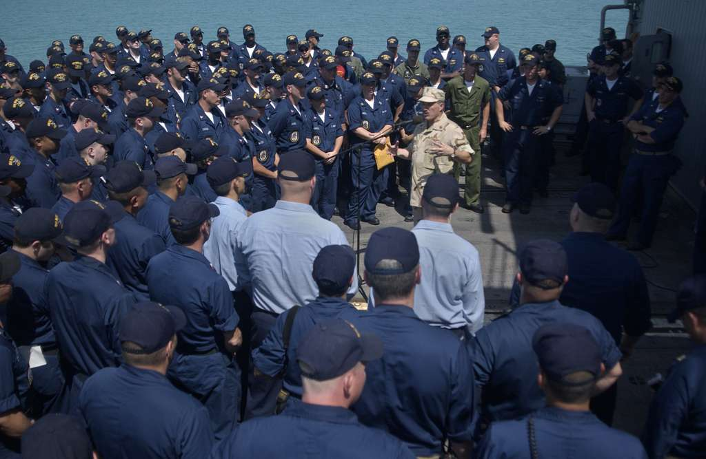 Master Chief Petty Officer of the Navy (MCPON) Terry Scott speaks to Sailors aboard guided missile cruiser USS Mobile Bay (CG 53) deployed in support of Operation Iraqi Freedom (OIF).