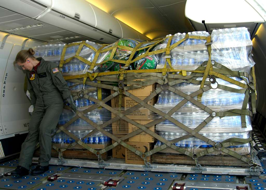 U.S. Navy Aviation Warfare Systems Operator 1st class Amy Skillings, a load master trainee assigned to Fleet Logistics Squadron Five Seven (VR-57), pushes into place, a pallet of relief supplies for the victims of Hurricane Katrina.