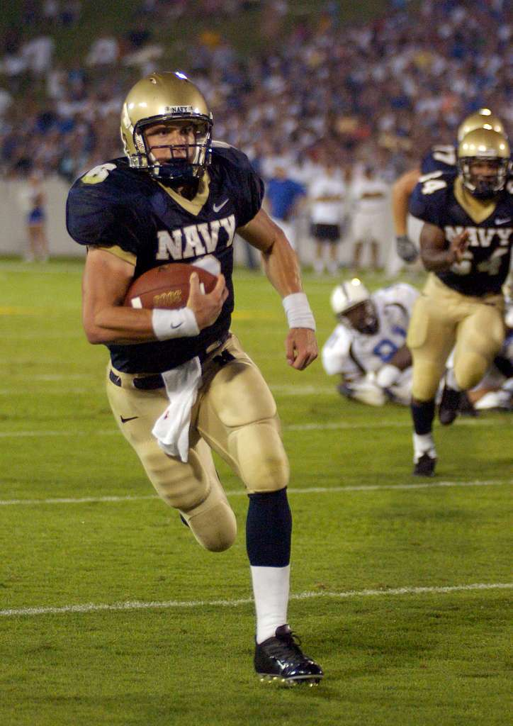 U.S. Naval Academy Midshipman 1st Class Aaron Polanco runs for a touchdown against the Duke Blue Devils to help Navy beat Duke 27-12 in the season opener for both teams