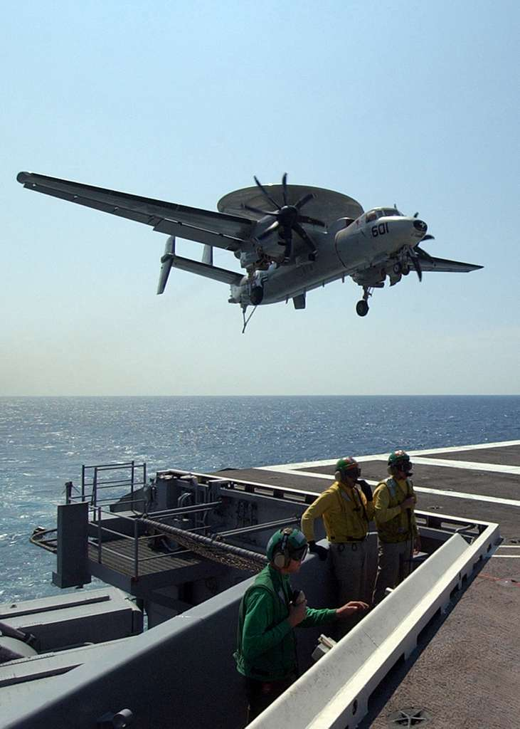 An E-2C+ Hawkeye comes in for an arrested landing aboard the Nimitz-class aircraft carrier USS Harry S. Truman (CVN 75).