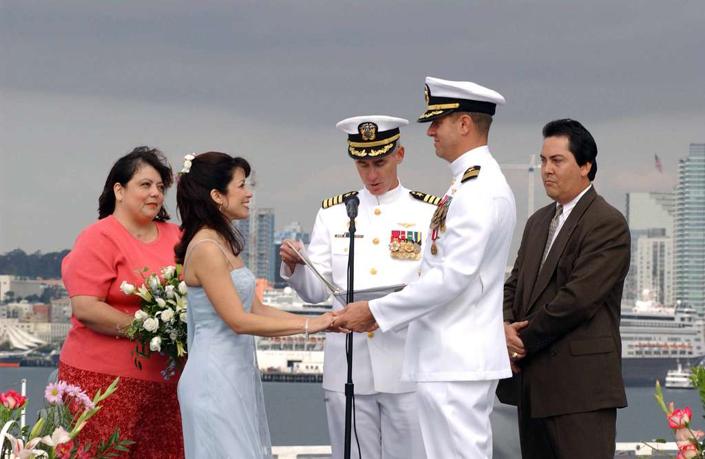 Cmdr. Charles Sternberg and his wife share their vows on the flight deck aboard the aircraft carrier USS Nimitz (CVN 68).