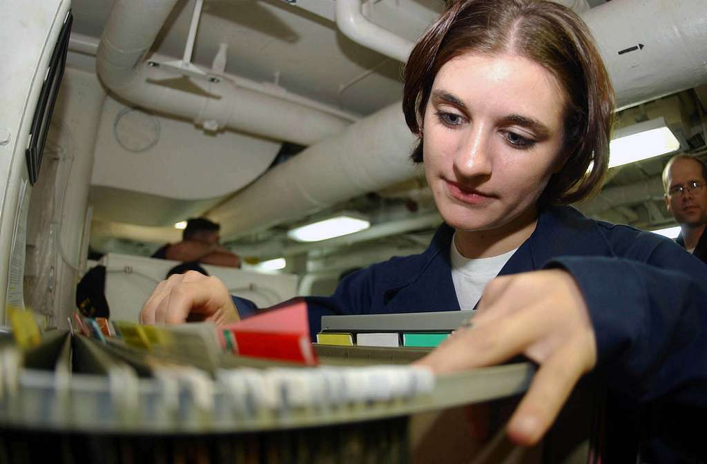Personnelman Christina Embleton of San Francisco, Calif., searches through personnel service records to update vital information for over 3,000 personnel aboard the aircraft carrier USS Nimitz (CVN 68).