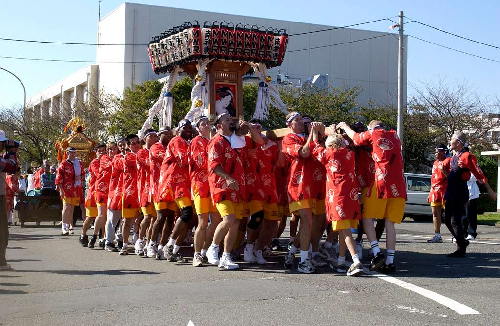 Sailors assigned to Fleet Activities Yokosuka, Japan, participate in a traditional Mikoshi parade, held annually in Yokosuka.