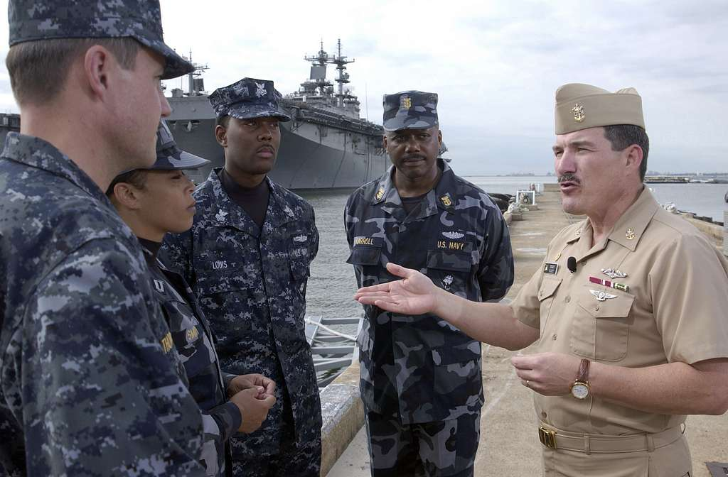 Master Chief Petty Officer of the Navy (MCPON) Terry Scott talks with the Sailors modeling the Navy's new working uniform concepts in Norfolk, Va.