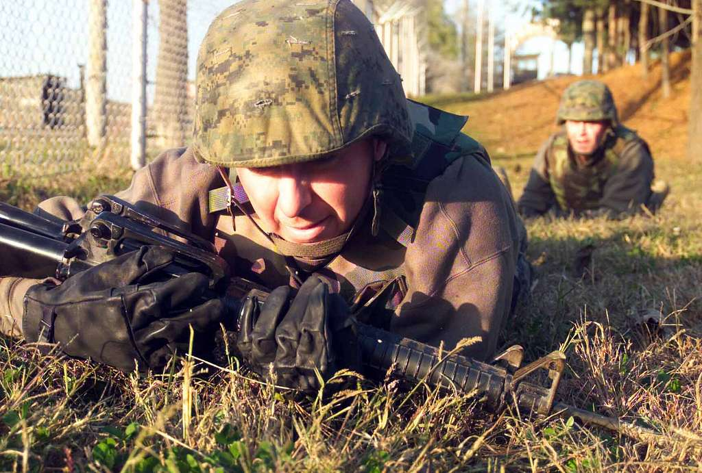 Staff Sgt. Jesus Rivera, assigned to the 9th Engineer Support Battalion (ESB), low crawls during the combat conditioning.