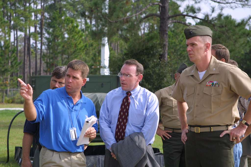 Assistant Program Manager for Integration, DJC2, Rob Maddox, left, explains aspects of the DJC2 system to Assistant Secretary of the Navy for Research, Development and Acquisition.