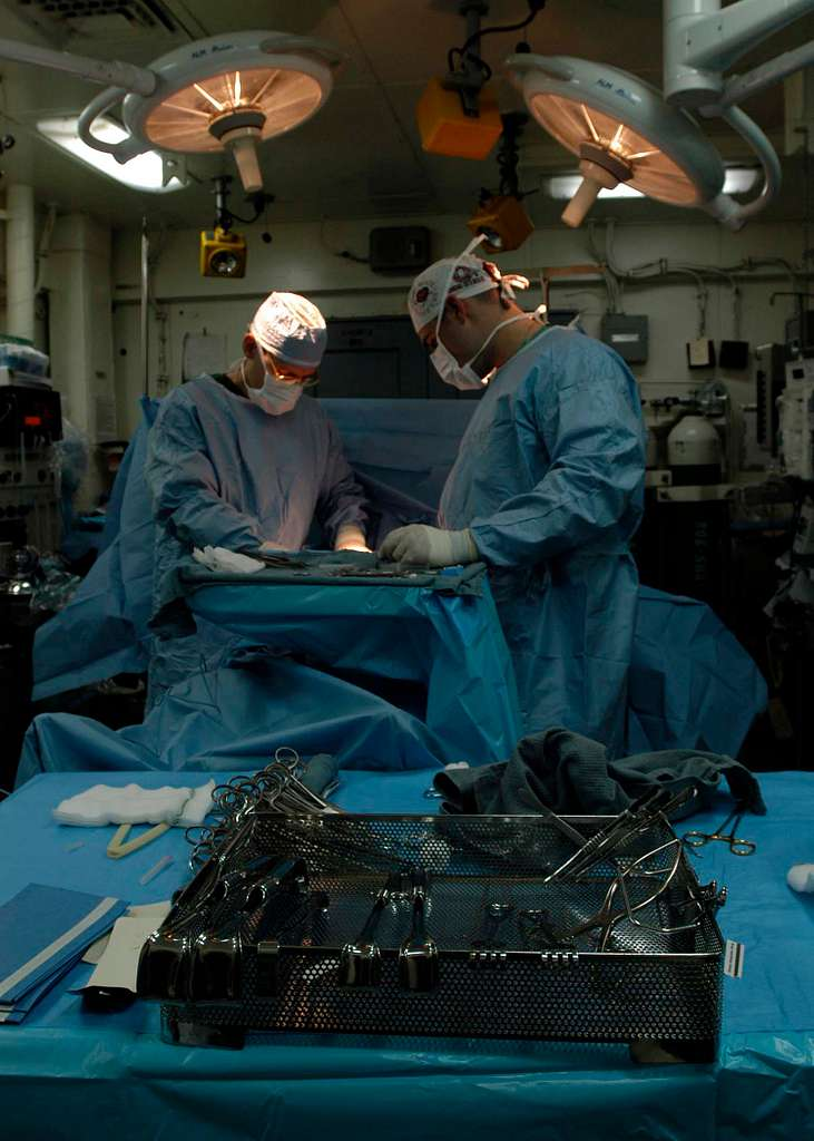 The Medical Department aboard the Nimitz-class aircraft carrier USS Abraham Lincoln (CVN 72) performs a delicate medical procedure.