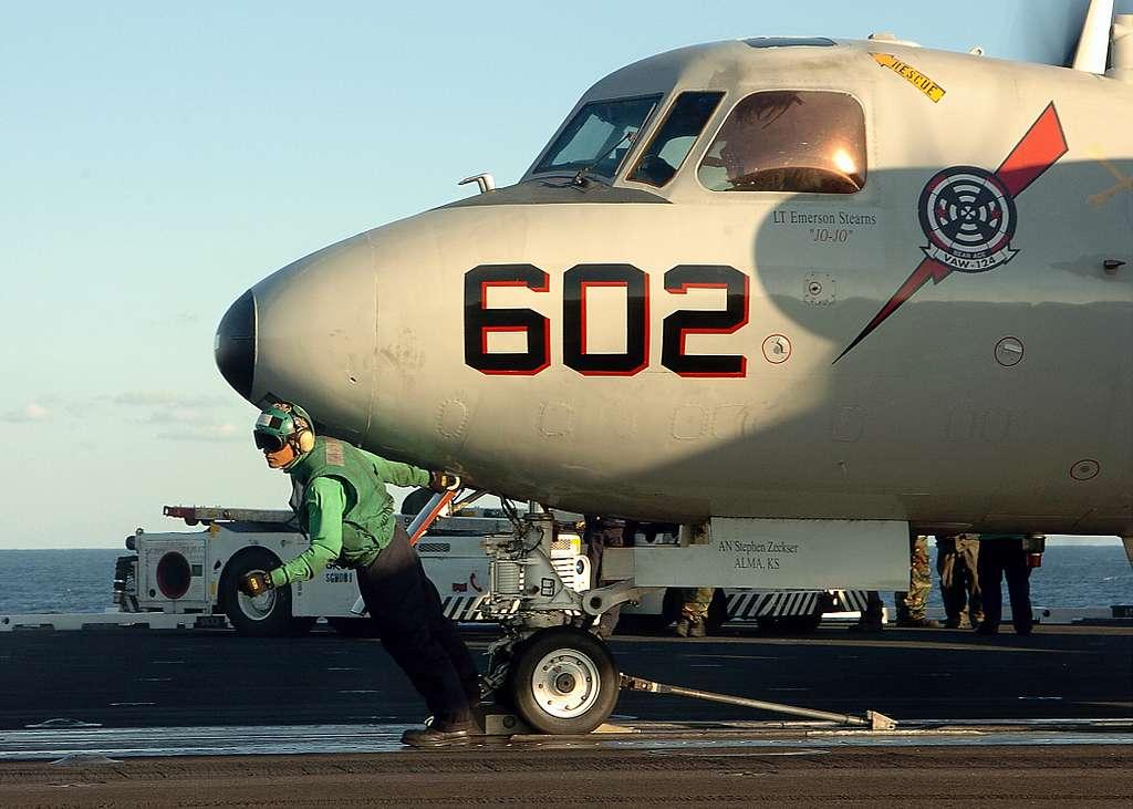 Aviation Boatswain�s Mate Airman Yeri Velez of Charlotte, N.C., directs an E-2C Hawkeye.