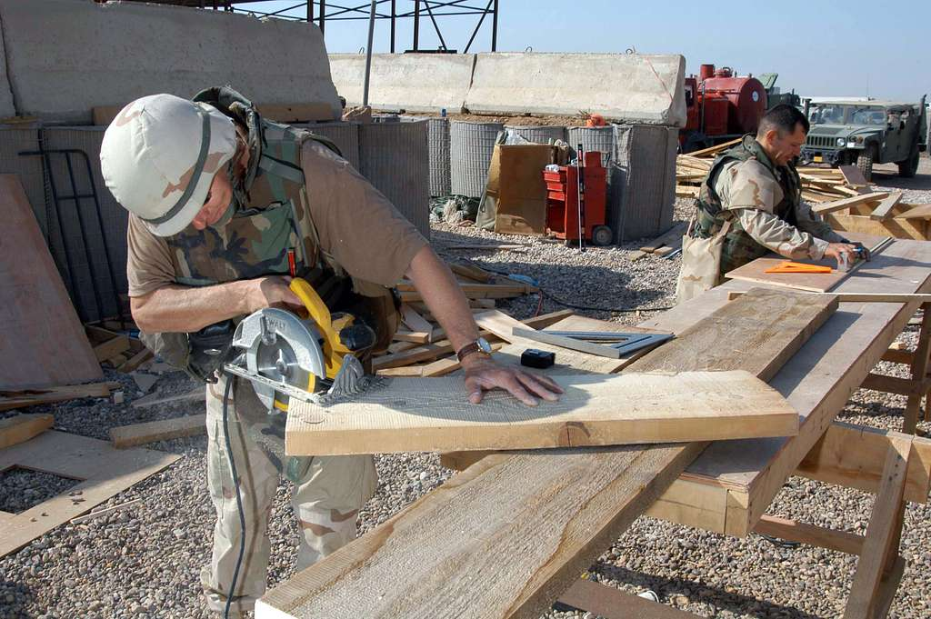 Construction Electrician 2nd Class Edmund Dougherty and Builder 1st Class David Bethke, both assigned to Naval Mobile Construction Battalion Two Three (NMCB-23), begin construction of stairs for a Southwest Asia (SWA) hut.