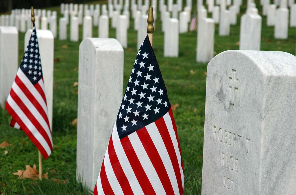 American flags decorate the headstones of service members at the Quantico National Cemetery in Triangle, Va., on Veteran's Day.