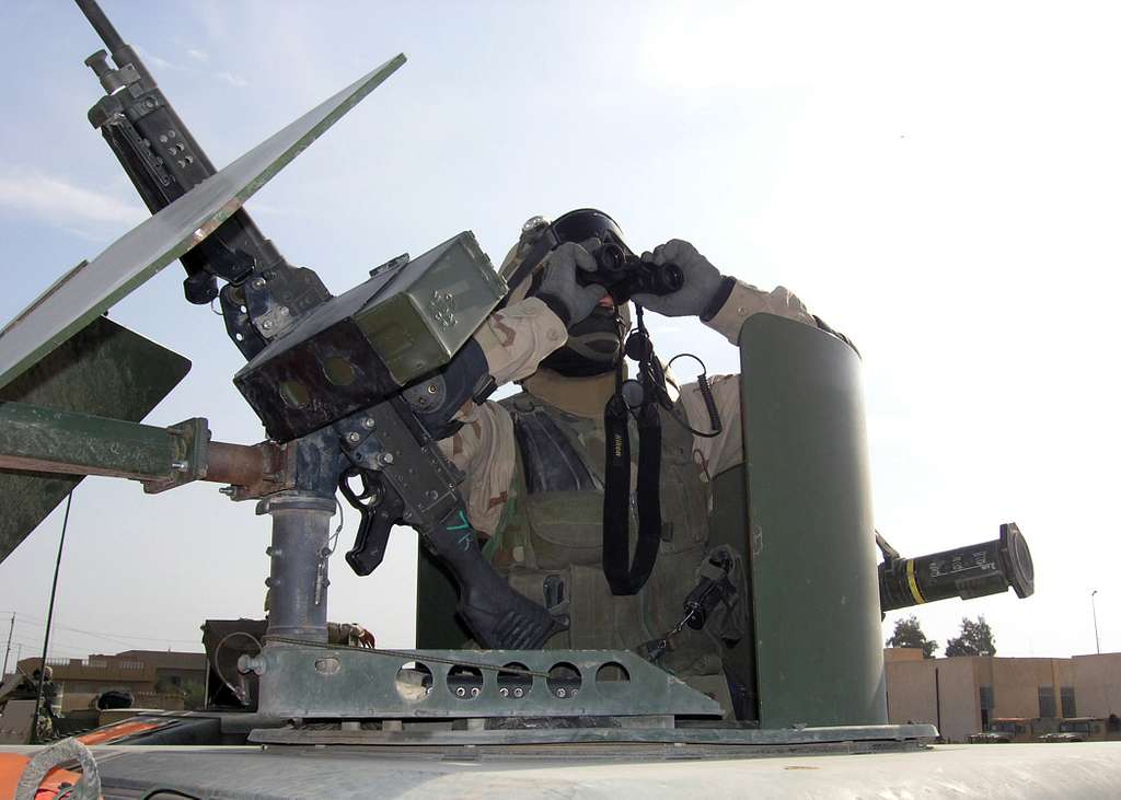 Construction Electrician 1st Class Press, assigned to the Tactical Movement Team (TMT) of Naval Mobile Construction Battalion Two Three (NMCB-23), scans the Fallujah horizon.