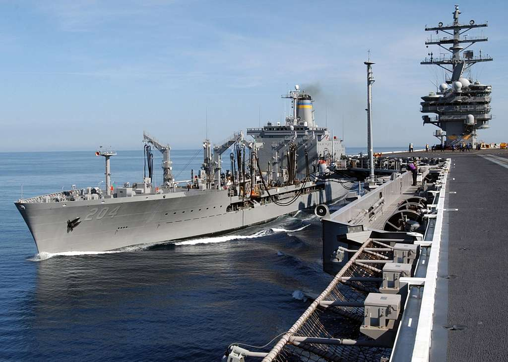 The Military Sealift Command (MSC) oiler USNS Rappahannock (T-AO 204) and Nimitz-class aircraft carrier USS Ronald Reagan (CVN 76) transfer fuel during a replenishment at sea.