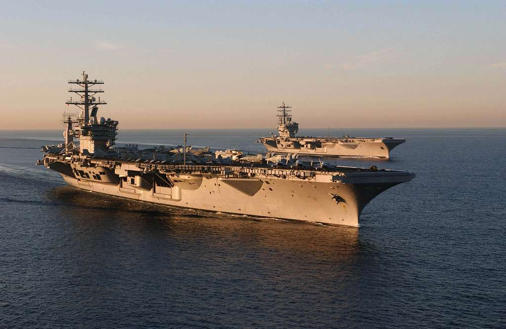 USS Nimitz (CVN 68), and USS Ronald Reagan (CVN 76) navigate alongside each other during routine training exercises off the southern California coast.