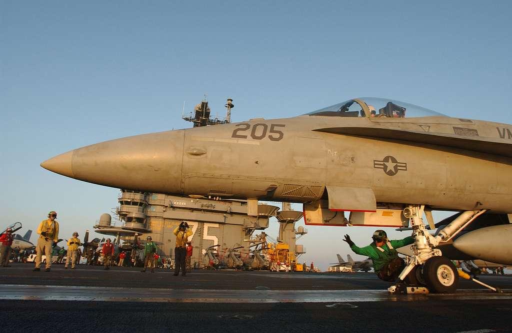 An F/A-18 Hornet prepares for launch aboard USS Harry S. Truman (CVN 75).