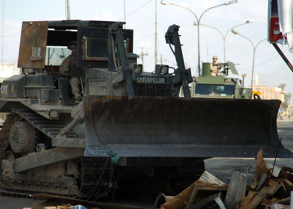 Equipment Operator 3rd Class Gerry Walker operates a Hi-Tracked bulldozer to clear debris from the streets of Fallujah, Iraq during Operation Al Fajr (New Dawn).