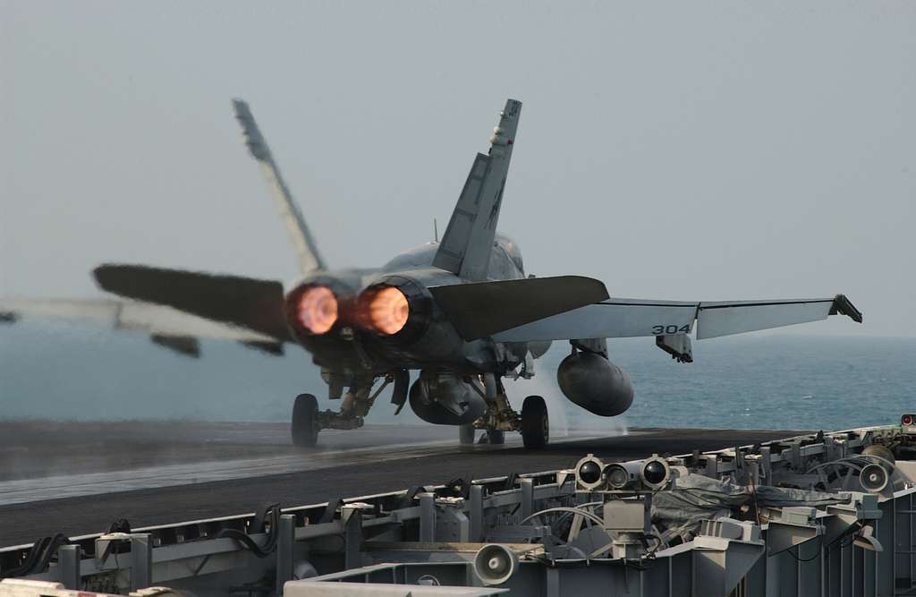 An F/A-18C Hornet is launched from one of four steam-powered catapults on the flight deck aboard USS Harry S. Truman (CVN 75).