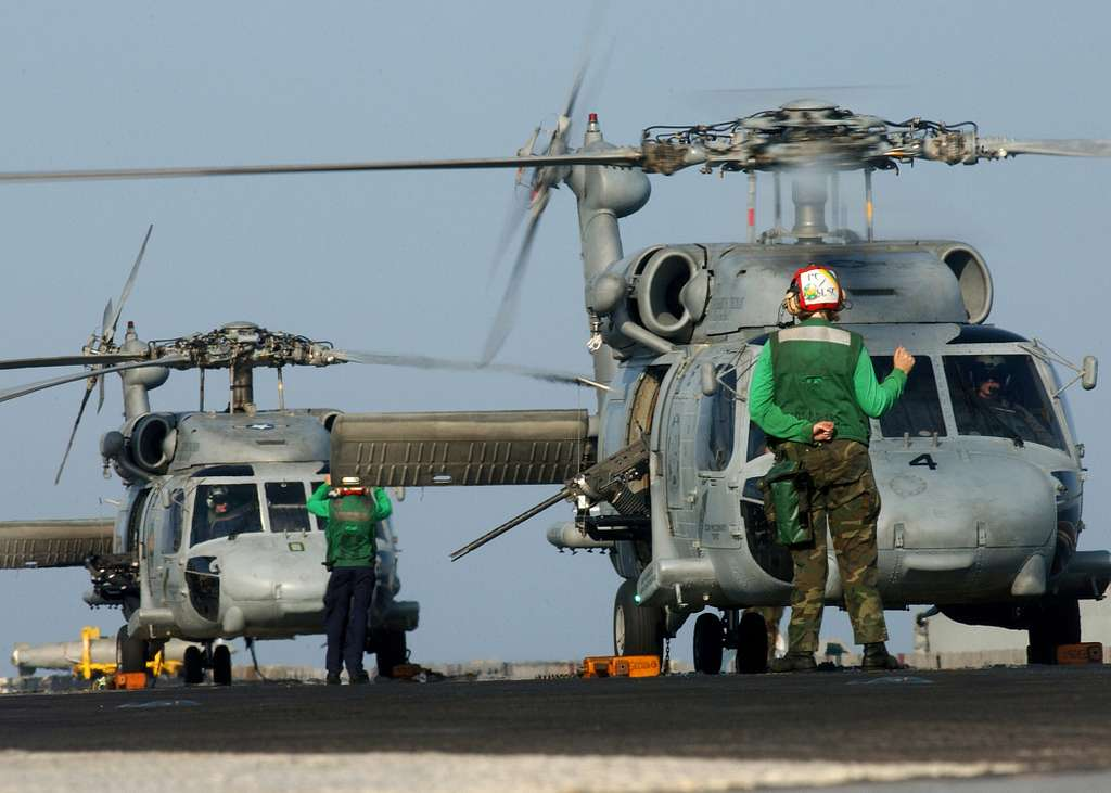 Two HH-60H Seahawk helicopters prepare to take off from the flight deck of USS Harry S. Truman (CVN 75).