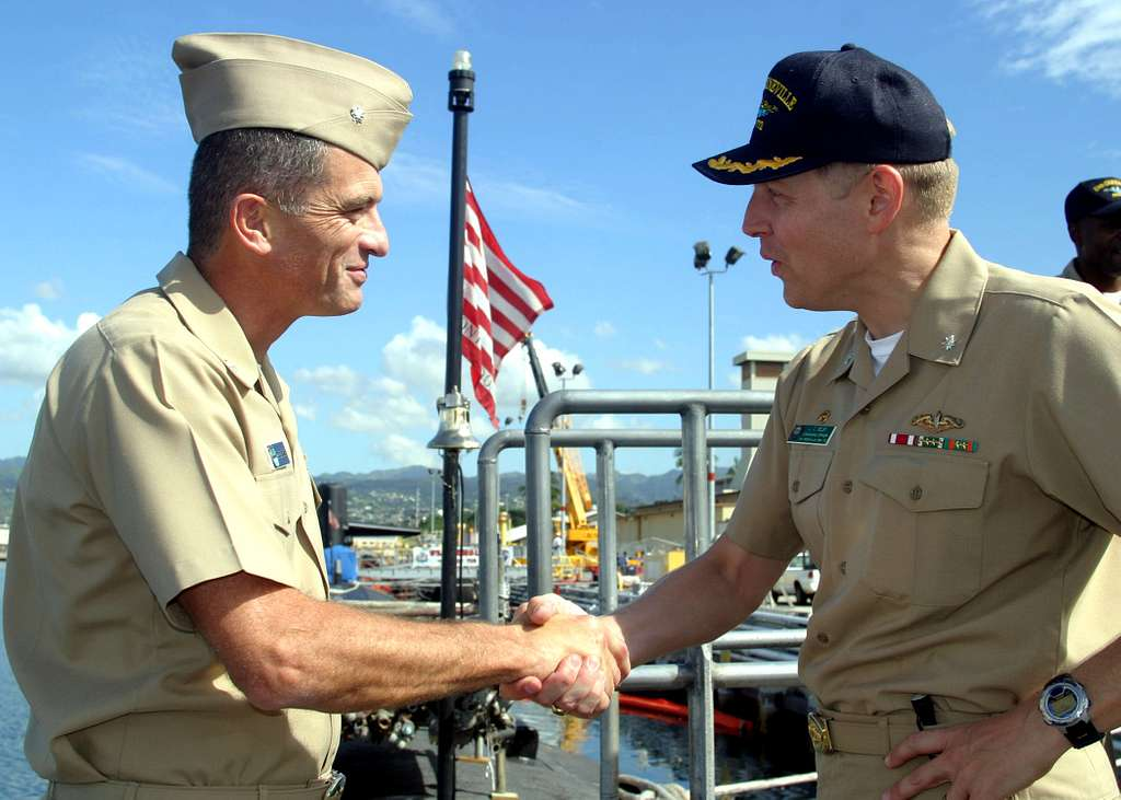 Former commanding officer of Los Angeles-class submarine USS Greeneville SSN 772, Cmdr. Lee Hankins, left, is greeted by the boats current Commanding Officer, Cmdr. Lorin Selby.