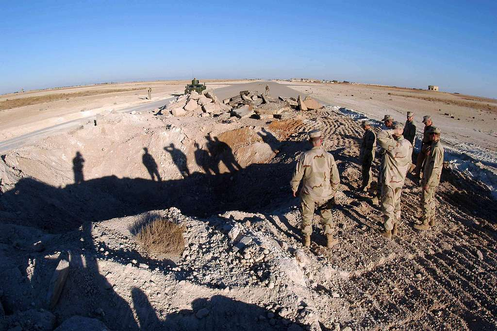 Commander, Naval Reserve Force, Vice Adm. John G. Cotton views a Seabee project at the Al Asad airfield in western Iraq.