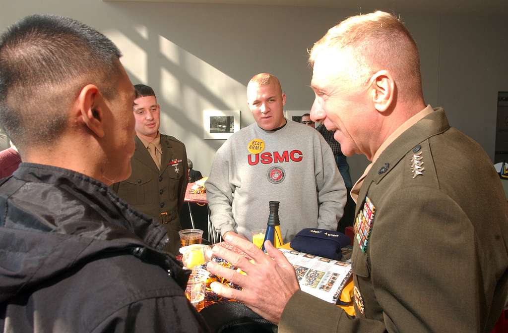 Commandant of the Marine Corps Gen. Michael W. Hagee, spends time with combat wounded Marines before the 105th Army-Navy game.