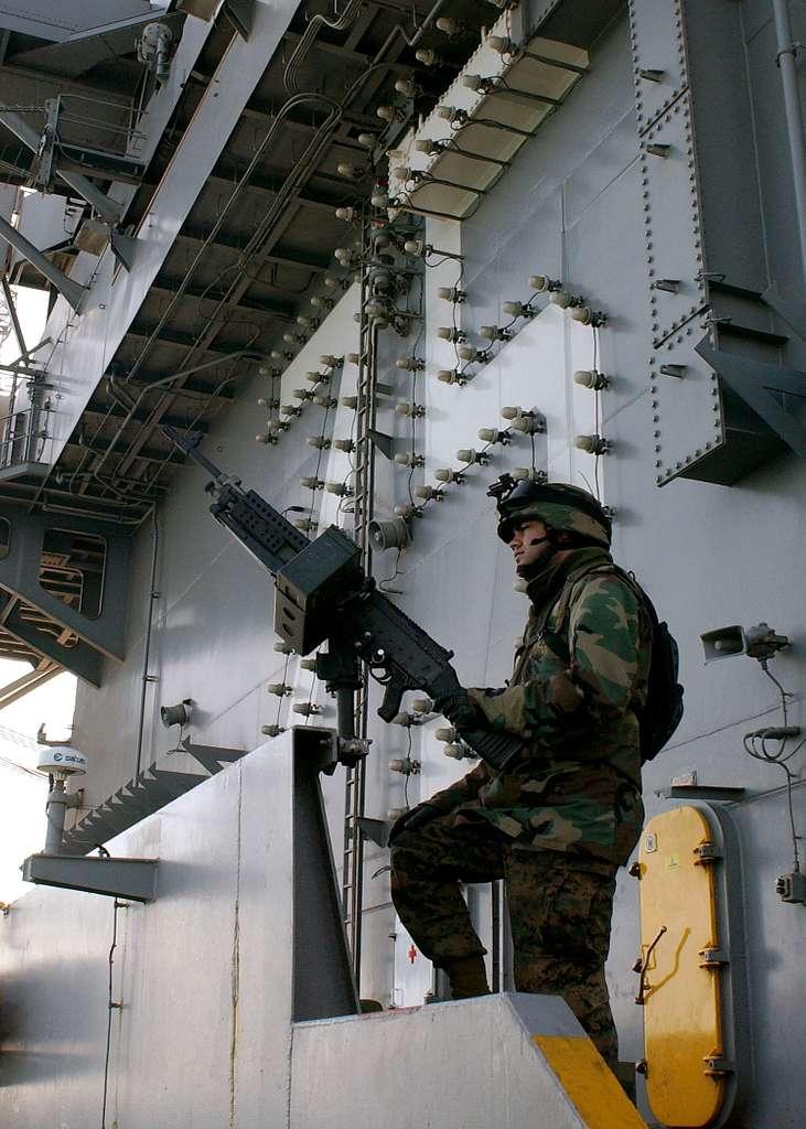 Marine Sgt. Joe Bartolomey scans the horizon while manning the starboard M-240G machine gun watch.
