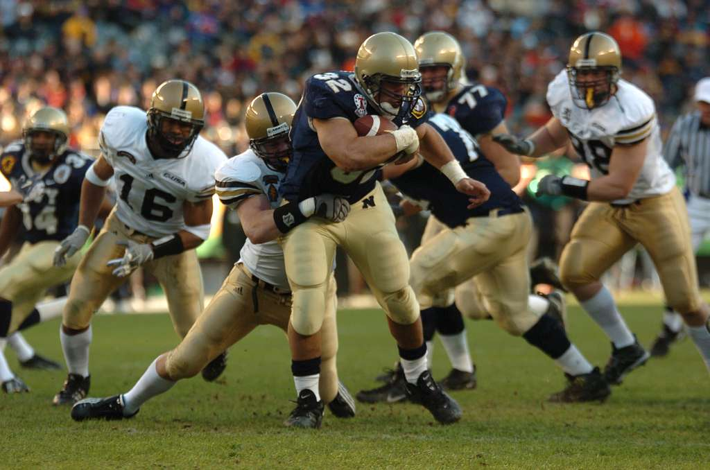 Navy full back Kyle Eckel breaks through defensive line at 105th Army Navy game.