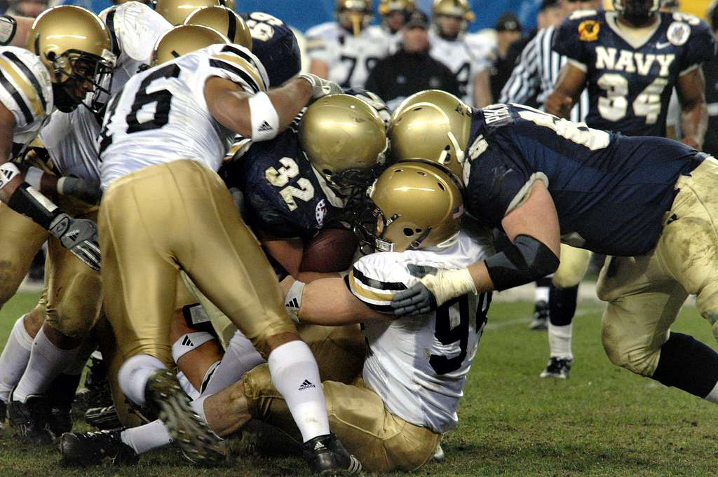 Navy Kyle Eckel fights for a first down, during the 105th Army Navy game.