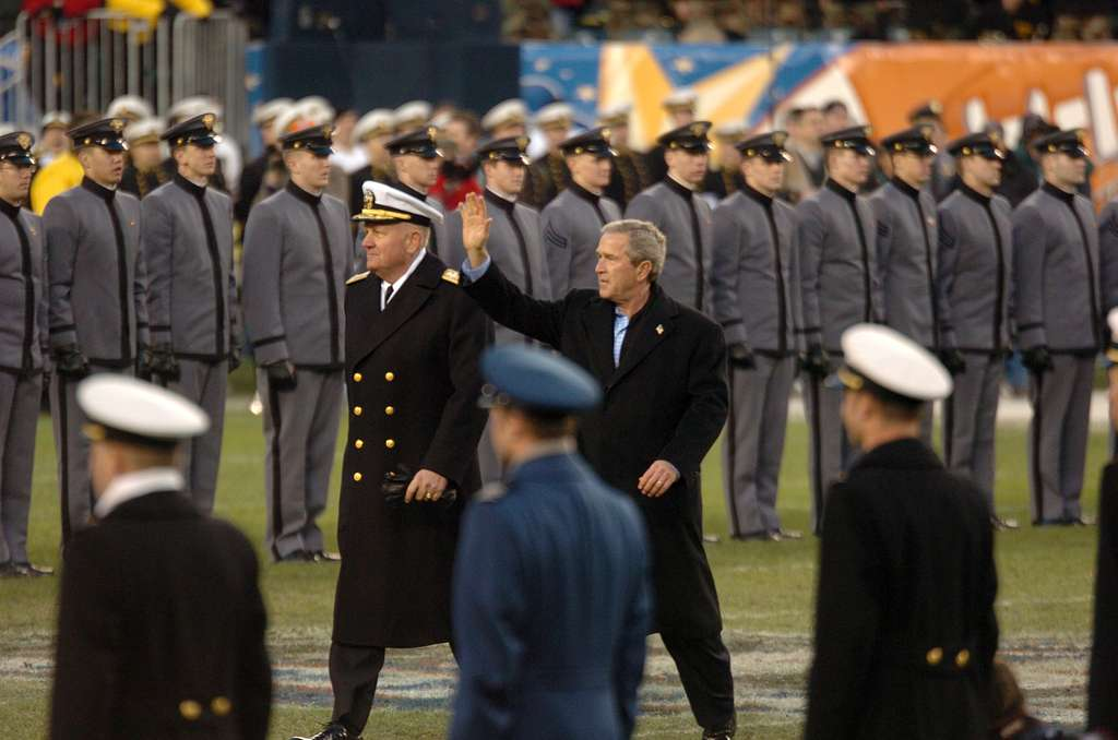 President Bush moves to the Navy side of the field during 105th Army Navy game.