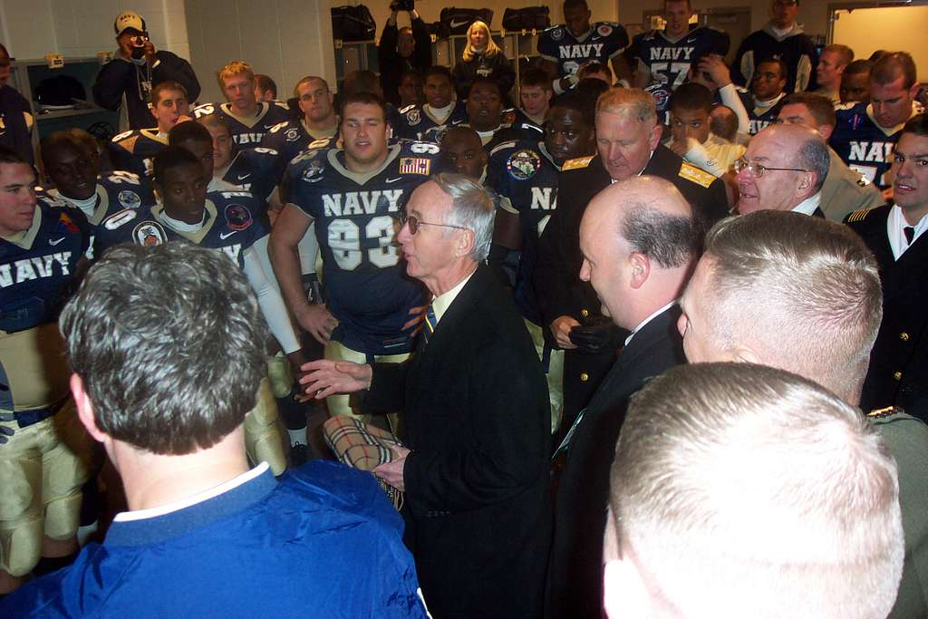 Secretary of the Navy Gordon R. England congratulates the Navy football team in their locker room following Navy's victory (42-13) in the 105th Army vs. Navy football game.