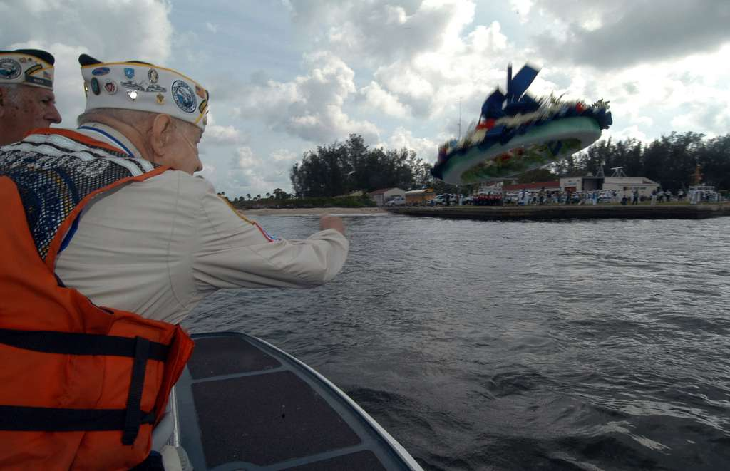 A Pearl Harbor Survivor throws a commemorative wreath into the waters of Port Everglades, Fla., during the 63rd anniversary of the attack on Pearl Harbor Remembrance Ceremony.