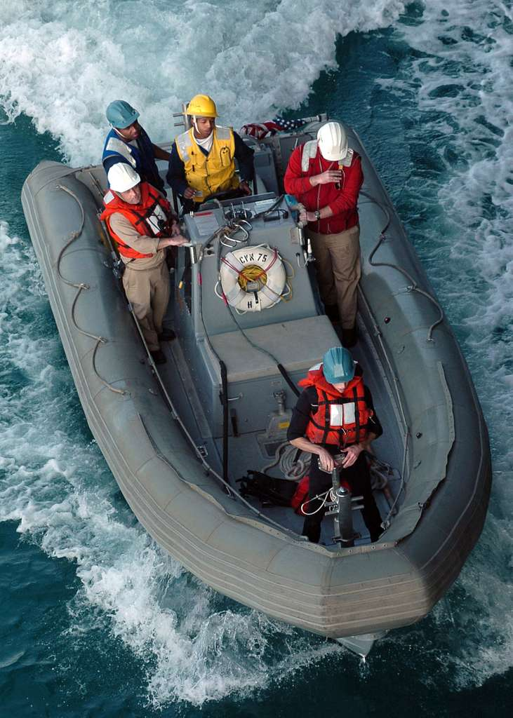 Sailors assigned to Deck Department aboard the Nimitz-class aircraft carrier USS Harry S. Truman (CVN 75), navigate a Riged Hull Inflatable Boat (RHIB) during a general quarters (GQ) drill.