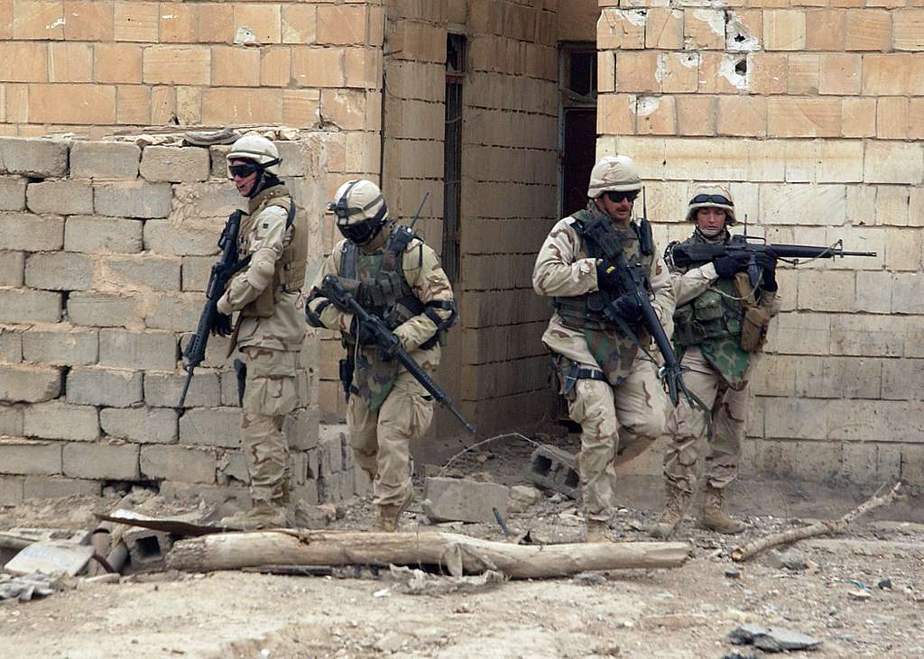 U.S. Navy Seabees, assigned to Naval Mobile Construction Battalion Two Three (NMCB-23), secure a severely damaged school in Fallujah, Iraq.