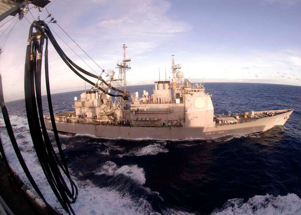The guided missile cruiser USS Shiloh (CG 67) prepare to receive fuel from the Military Sealift Command (MSC) fast combat support ship USNS Rainier (T-AOE 7) during an underway replenishment.