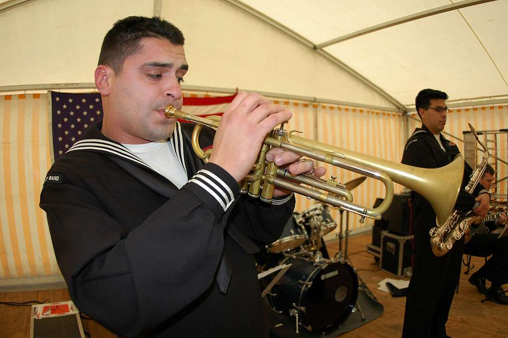 Musician 3rd Class Jason Hanna, a Jazz trumpets in the Commander Sixth Fleet Jazz Ensemble, entertains World War II veterans, active duty Soldiers and Sailors during a luncheon honoring the liberation of Clervaux, Belgium.