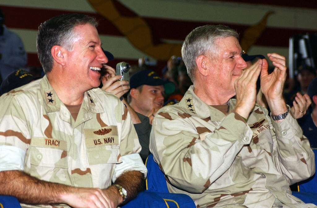 Rear Adm. Michael Tracy, left, sits with Chairman of the Joint Chiefs of Staff, Gen. Richard Myers, during a USO Show.