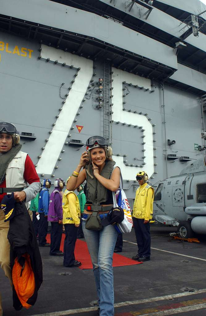Television personality and model Leann Tweedan departs the Nimitz-class aircraft carrier USS Harry S. Truman (CVN 75).