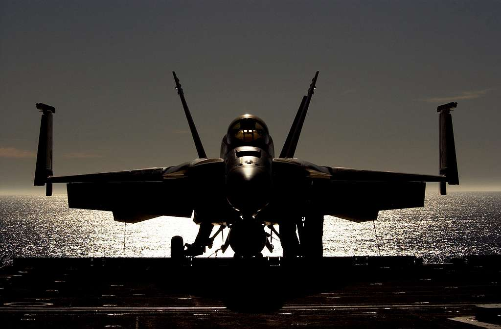 An F/A-18E Super Hornet from the Flying Eagles of Strike Fighter Squadron One Two Two (VFA-122) prepares to be lowered to the hangar deck aboard USS Ronald Reagan (CVN 76).