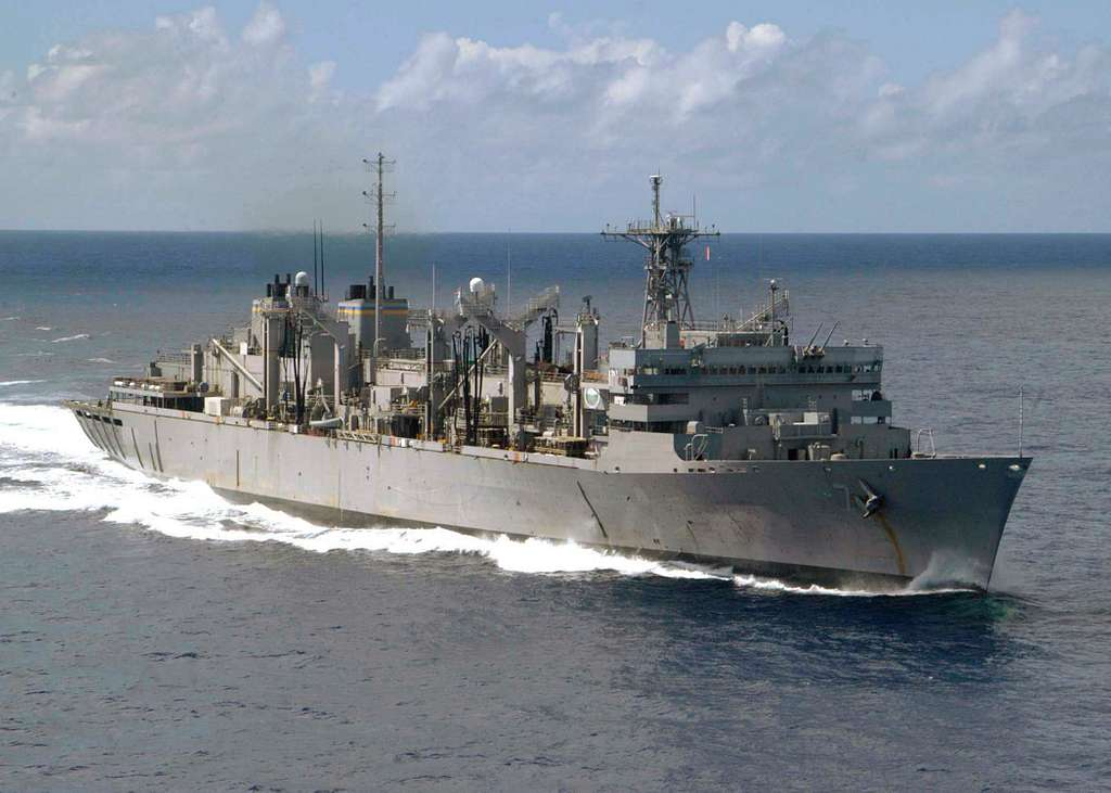 The Military Sealift Command (MSC) fast combat support ship USNS Rainier (T-AOE 7) shown underway in the Western Pacific Ocean.